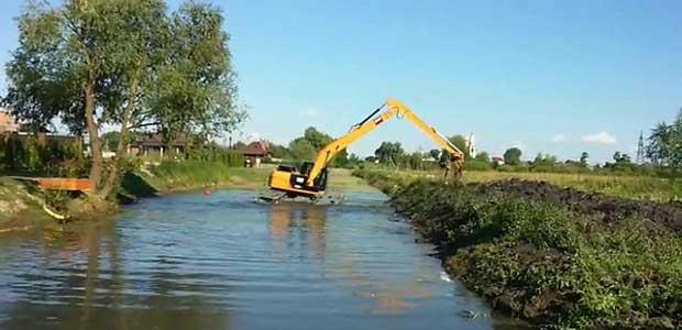 Очистка водоемов, прудов, искусственных и естественных озер.